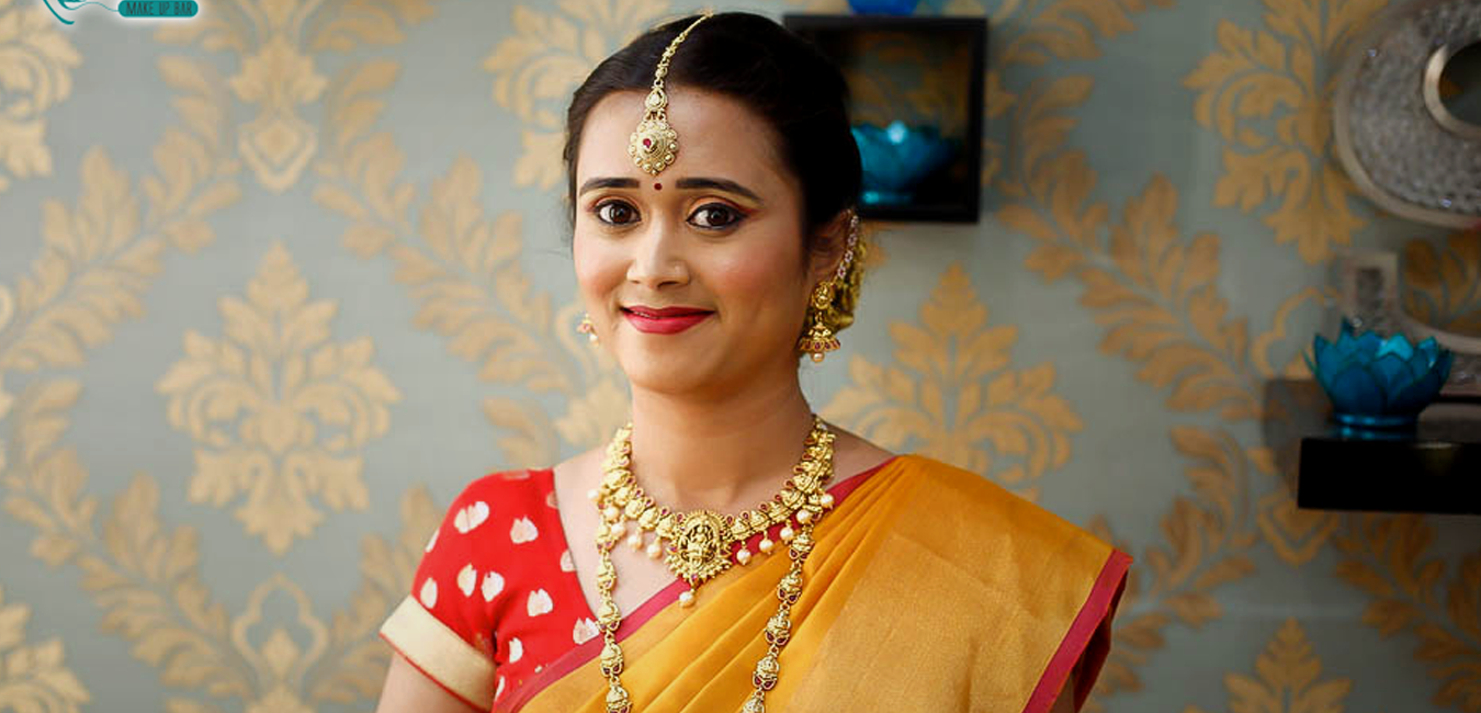 Portrait of a traditional south Indian bride in yellow saree with wedding makeup