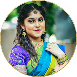 beautiful woman in blue color saree with wedding makeup done by skulpt celebrity bridal makeup artist chennai