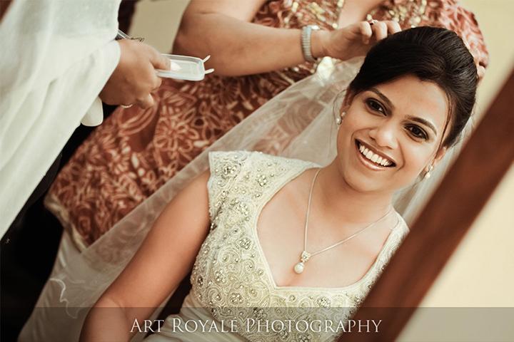 makeup artist applying makeup to a catholic bride for her wedding ceremony