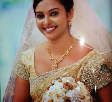 smiling bride with wedding veil holding bouquet on her wedding ceremony