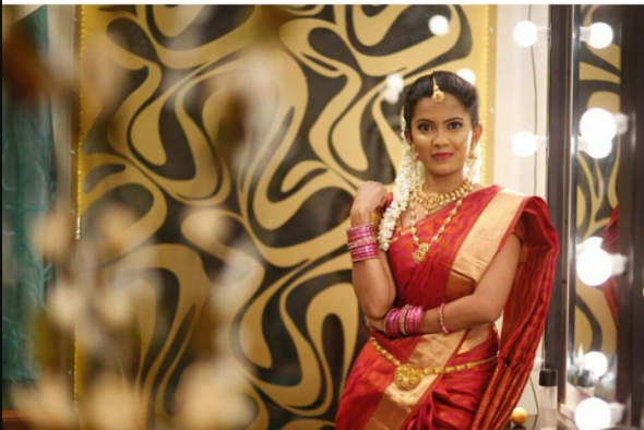 beautiful woman in traditional saree with bridal makeup by makeup artist chennai