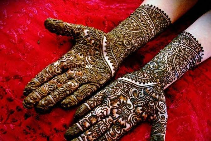 bridal hands with wedding mehandi designs