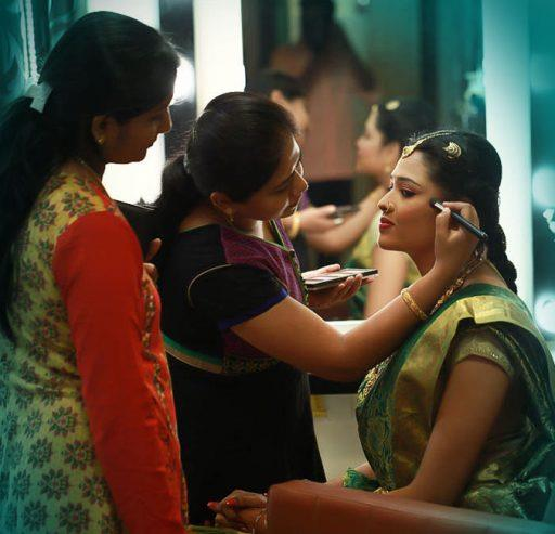Makeup artist applying makeup to a woman at Skulpt Makeup Bar