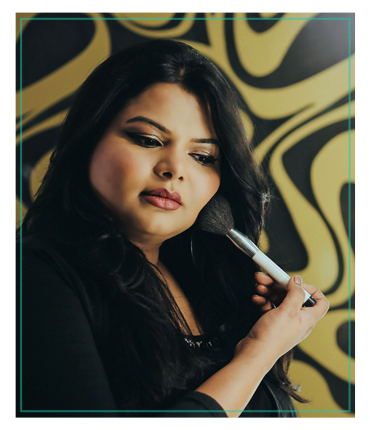 Portrait of professional makeup artist of Skulpt academy with makeup brush