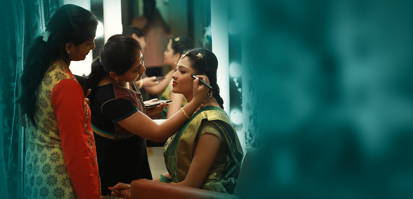Makeup Artist in Chennai applying makeup to a bride