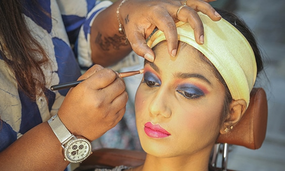 Chennai Makeup artist applying eye liner to a woman