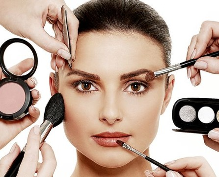 beautiful woman with various makeup tool kits