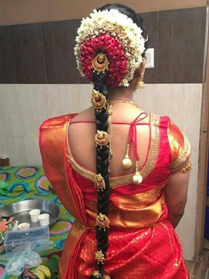 Traditional South Indian bride's bridal braid hairstyle by Skulpt professional wedding makeup artist in chennai